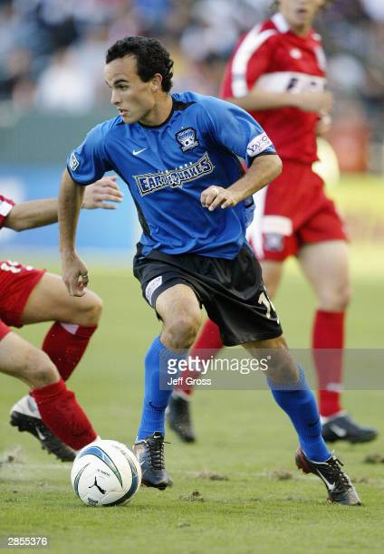 Landon Donovan of the San Jose Earthquakes dribbles against the defense of the Chicago Fire during the MLS Cup on November 23 2003 at the The Home...