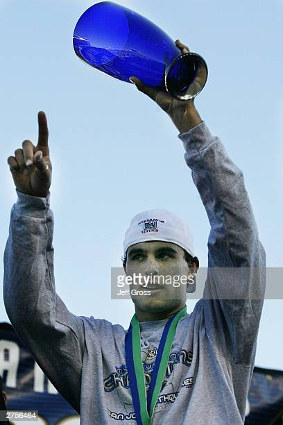 Landon Donovan of the San Jose Earthquakes holds the MVP cup after defeating of the Chicago Fire 42 in the MLS Cup on November 23 2003 at The Home...