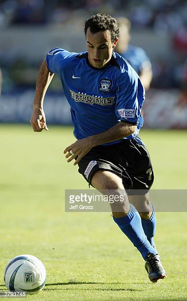 Landon Donovan of the San Jose Earthquakes looks to advance the ball against the Chicago Fire during the MLS Cup on November 23 2003 at the The Home...