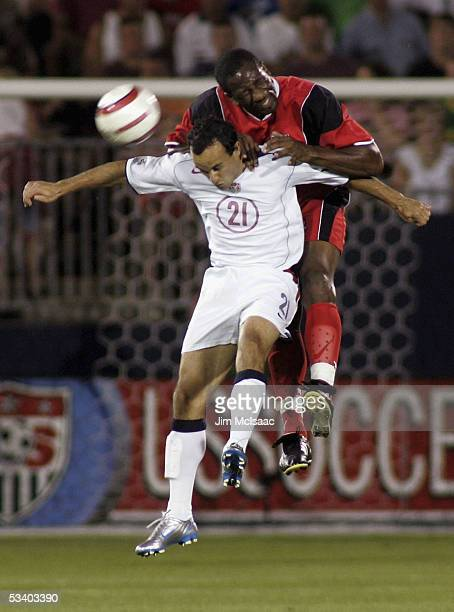 Landon Donovan of the United States and Marvin Andrews of Trinidad and Tobago battle for the ball during their World Cup Qualifier match at...