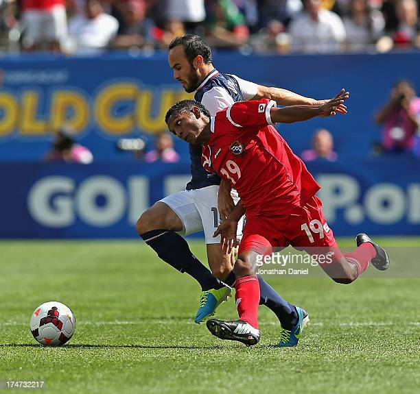 Landon Donovan of the United States battles with Alberto Quintero of Panama during the CONCACAF Gold Cup final match at Soldier Field on July 28 2013...