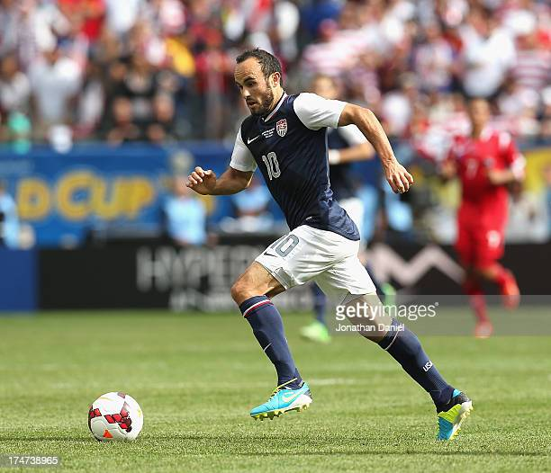 Landon Donovan of the United States brings the ball up the field against Panama during the CONCACAF Gold Cup final match at Soldier Field on July 28...