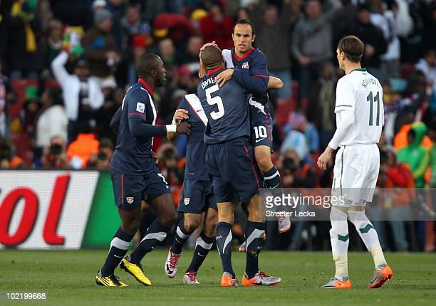 Landon Donovan of the United States celebrates scoring his team's first goal with team mate Oguchi Onyewu during the 2010 FIFA World Cup South Africa...