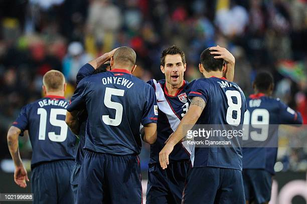 Landon Donovan of the United States celebrates scoring his team's first goal with team mates Oguchi Onyewu and Carlos Bocanegra during the 2010 FIFA...