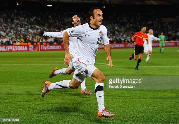 Landon Donovan of the United States celebrates scoring the winning goal that sends the USA through to the second round during the 2010 FIFA World Cup...