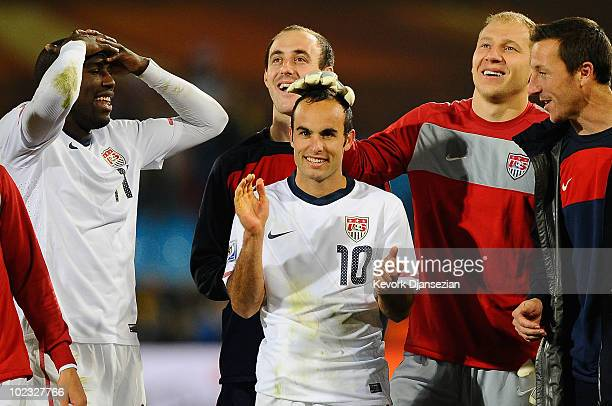 Landon Donovan of the United States celebrates victory with team mates that sends the USA through to the second round in the 2010 FIFA World Cup...