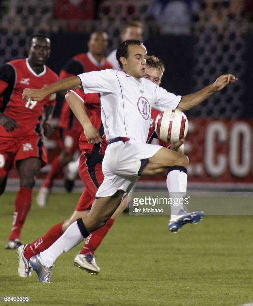 Landon Donovan of the United States controls the ball against Christopher Burchall of Trinidad and Tobago during their World Cup Qualifier match at...