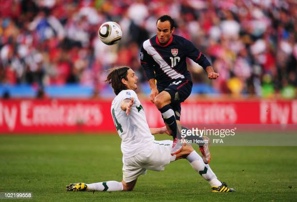 Landon Donovan of the United States is tackled by Marko Suler of Slovenia during the 2010 FIFA World Cup South Africa Group C match between Slovenia...