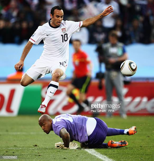 Landon Donovan of the United States jumps over Rais M'Bolhi of Algeria during the 2010 FIFA World Cup South Africa Group C match between USA and...