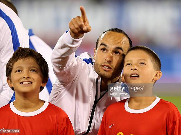 Landon Donovan of the United States points into the stands during pregame against Ecuador during an international friendly at Rentschler Field on...