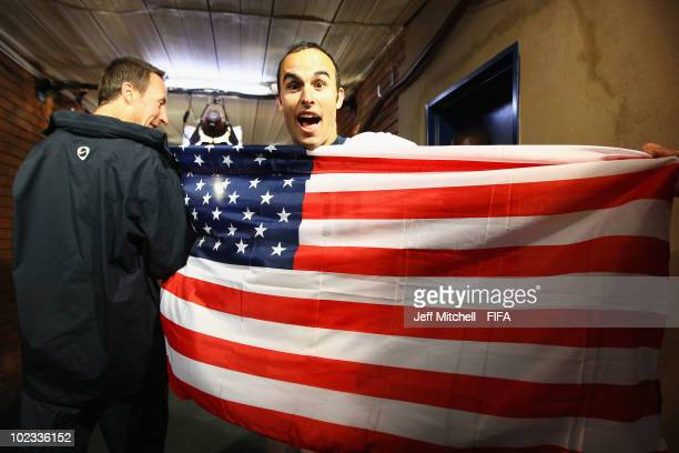 Landon Donovan of the United States poses with his national flag after the 2010 FIFA World Cup South Africa Group C match between USA and Algeria at...