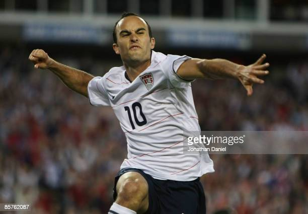 Landon Donovan of the US celebrates an assist on a goal by teammate Jozy Altidore in action against Trinidad and Tobago during a FIFA 2010 World Cup...