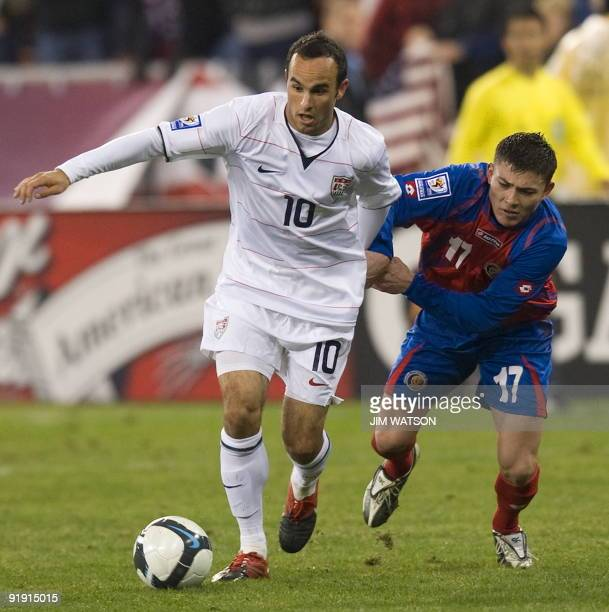 Landon Donovan of the US vies for the ball with Pablo Herrera of Costa Rica during US v Costa Rica World Cup Qualifing match in Washington DC October...