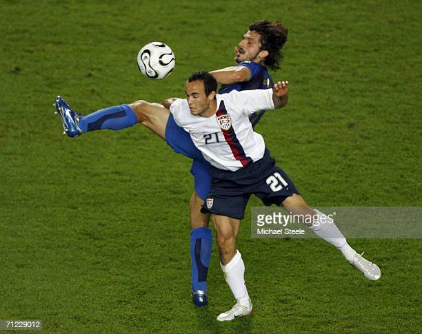 Landon Donovan of the USA battles for the ball with Gennaro Gattuso of Italy during the FIFA World Cup Germany 2006 Group E match between Italy and...