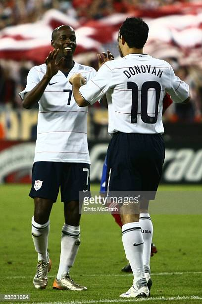 Landon Donovan of the USA celebrates scoring a goal with teammate DaMarcus Beasley during the FIFA World Cup 2010 qualifying match between Cuba and...
