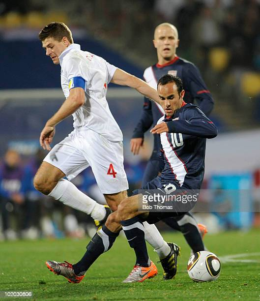 Landon Donovan of the USA clashes with Steven Gerrard of England during the 2010 FIFA World Cup South Africa Group C match between England and USA at...