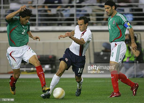 Landon Donovan of USA plays the ball between Ricardo Osorio and Rafael Marquez of Mexico during their international friendly match on February 7 2007...
