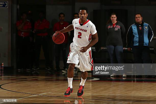 Landon Drew of the Cal State Northridge Matadors dribbles the ball against the Hope International Royals during the first half of the game at The...