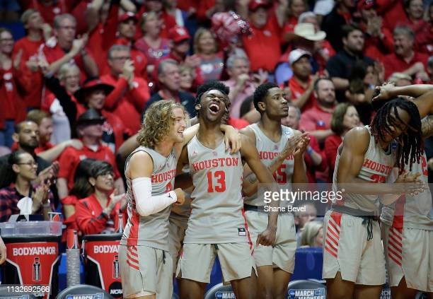 Landon Goesling of the Houston Cougars and Dejon Jarreau of the Houston Cougars are all smiles on the bench in the second round of the 2019 NCAA...