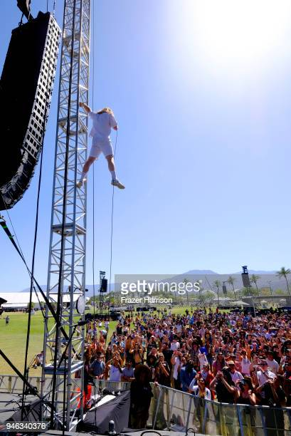Landon Jacobs of Sir Sly climbs the stage trusses during 2018 Coachella Valley Music And Arts Festival Weekend 1 at the Empire Polo Field on April 14...