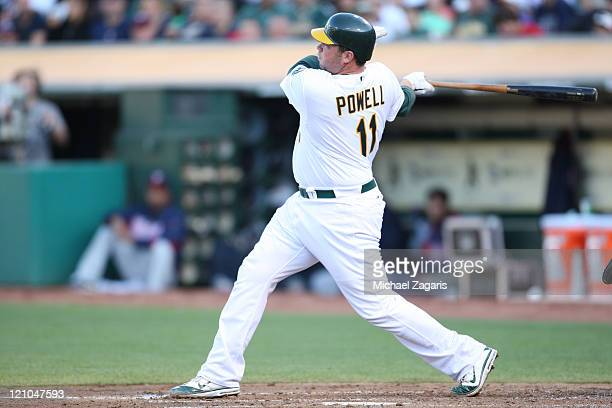 Landon Powell of the Oakland Athletics bats against the Minnesota Twins at the OaklandAlameda County Coliseum on July 30 2011 in Oakland California...