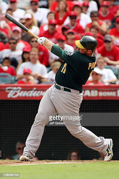 Landon Powell of the Oakland Athletics hits a foul ball as he bats against the Los Angeles Angels of Anaheim in the sixth inning at Angel Stadium of...