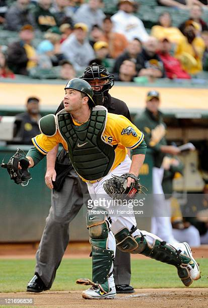 Landon Powell of the Oakland Athletics hustle after a foul ball against the Toronto Blue Jays during an MLB baseball game at the Oco Coliseum August...