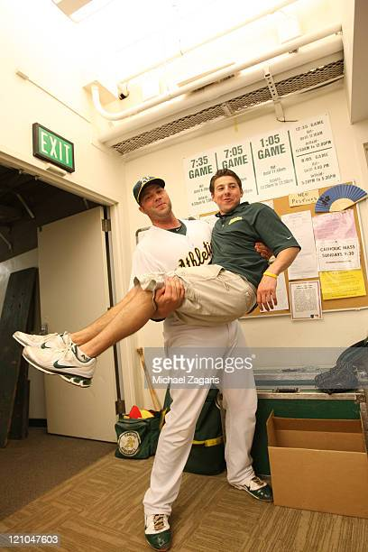 Landon Powell of the Oakland Athletics lifts one of the clubbies in the clubhouse prior to the game against the Minnesota Twins at the OaklandAlameda...