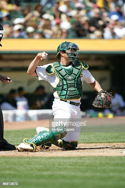 Landon Powell of the Oakland Athletics throws the ball during the game against the Seattle Mariners at the Oakland Coliseum on April 11, 2009 in...