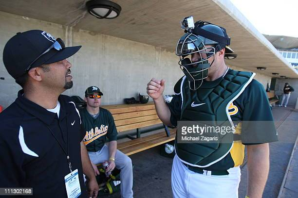 Landon Powell of the Oakland Athletics wears a mini cam on top of his catcher's helmet during an intrasquad game at Phoenix Municipal Stadium on...