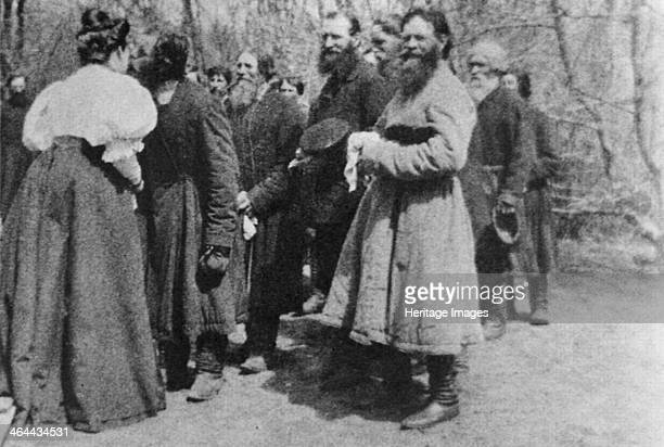 Landowner giving the Paschal greeting to her peasants, Russia, 1890s. The Paschal greeting is an Easter tradition in some Christian churches,...