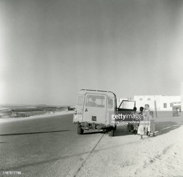 [Landrover at roadside, Ajman], United Arab Emirates.
