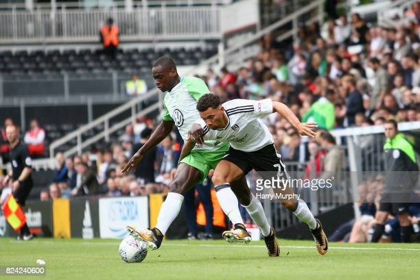 Landry Dimata of VfL Wolfsburg and Ryan Fredericks of Fulham battle fore possession during the PreSeason Friendly match between Fulham and VfL...