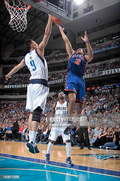 Landry Fields of the New York Knicks goes in for the layup against Yi Jianlian of the Dallas Mavericks on March 6 2012 at the American Airlines...