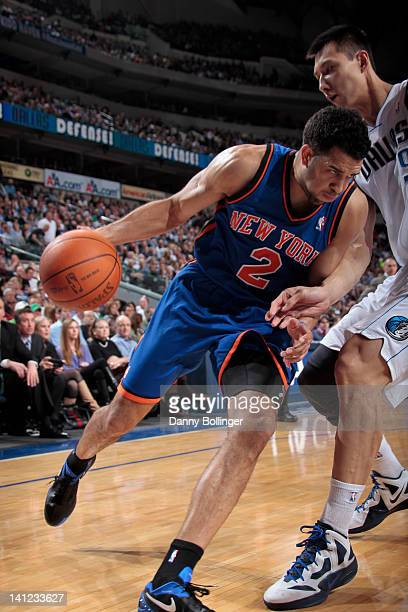 Landry Fields of the New York Knicks posts up against Yi Jianlian of the Dallas Mavericks on March 6 2012 at the American Airlines Center in Dallas...
