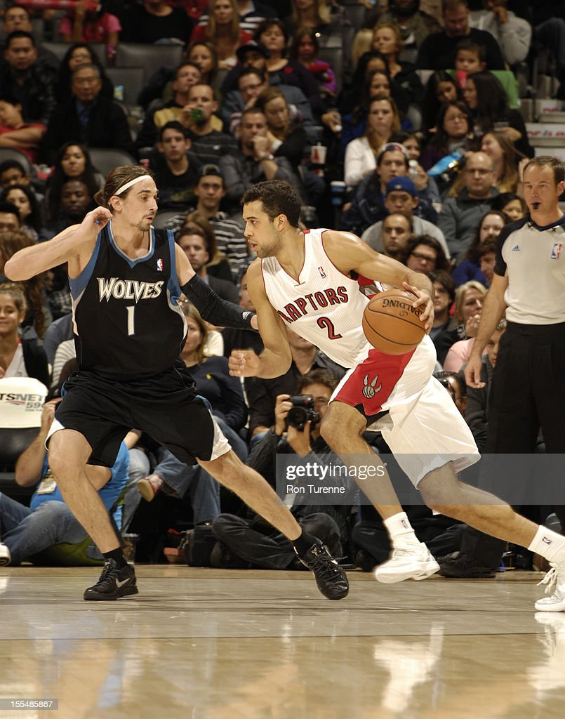 Landry Fields #2 of the Toronto Raptors drives to the hoop Alexey Shved #1 of Minnesota Timberwolves gaurds him , during the game on November 4, 2012 at the Air Canada Centre in Toronto, Ontario, Canada.