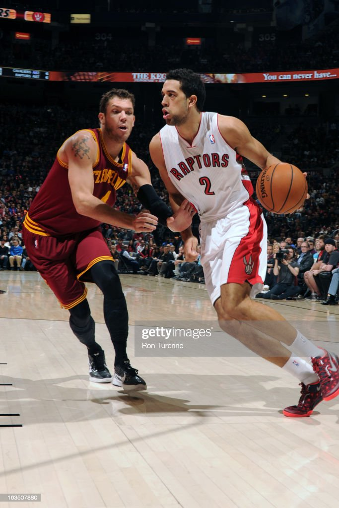 Landry Fields #2 of the Toronto Raptors handles the ball against Luke Walton #4 of the Cleveland Cavaliers on March 10, 2013 at the Air Canada Centre in Toronto, Ontario, Canada.