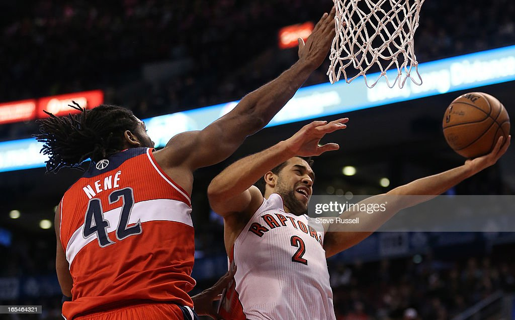 Landry Fields tries to get the ball past Nene in second half action as the Toronto Raptors beat the Washington Wizards 88-78 at the Air Canada Centre in Toronto.