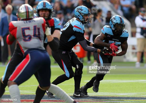 Landry Jones hands off to Lance Dunbar of the Dallas Renegades in the first half at an XFL football game on March 01 2020 in Arlington Texas
