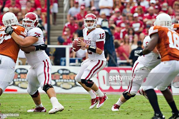 Landry Jones of the Oklahoma Sooners drops back to pass against the Texas Longhorns at the Cotton Bowl on October 8 2011 in Dallas Texas The Sooners...