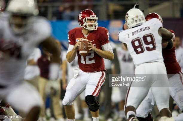 Landry Jones of the Oklahoma Sooners throws a pass against the Texas AM Aggies during the ATT Cotton Bowl on January 4 2013 at Cowboys Stadium in...