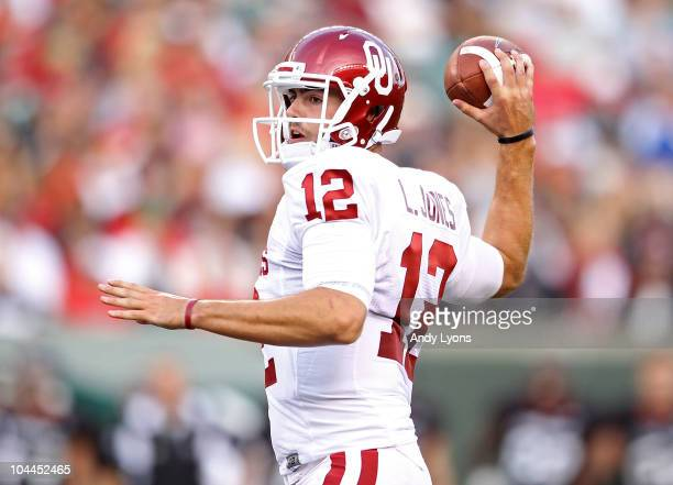 Landry Jones of the Oklahoma Sooners throws a pass during the game against the Cincinnati Bearcats at Paul Brown Stadium on September 25, 2010 in...