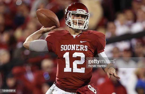 Landry Jones of the Oklahoma Sooners throws against the Notre Dame Fighting Irish at Gaylord Family Oklahoma Memorial Stadium on October 27 2012 in...