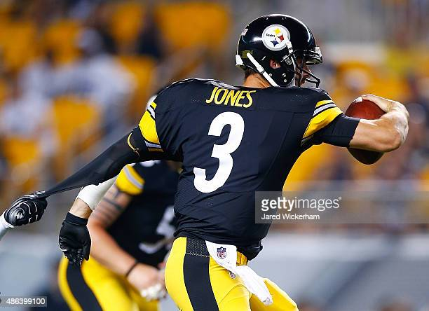 Landry Jones of the Pittsburgh Steelers has his jersey ripped while running with the ball in the first half against the Carolina Panthers during the...