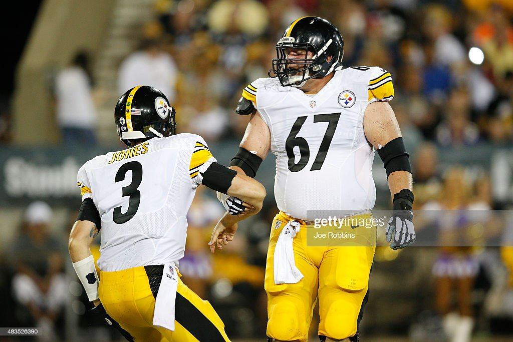 Landry Jones #3 of the Pittsburgh Steelers is helped up by B.J. Finney #67 after being knocked down against the Minnesota Vikings in the second half of the NFL Hall of Fame Game at Tom Benson Hall of Fame Stadium on August 9, 2015 in Canton, Ohio.
