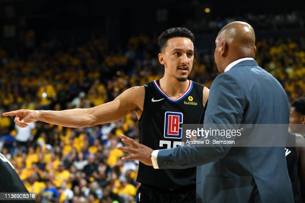 Landry Shamet and Head Coach Doc Rivers of the LA Clippers talk during Game One of Round One of the 2019 NBA Playoffs against the Golden State...