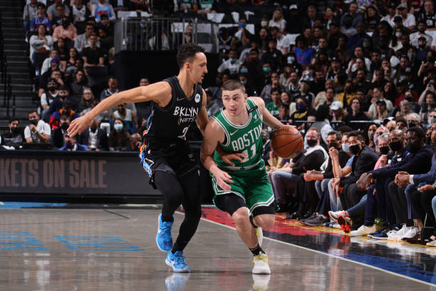 Landry Shamet of the Brooklyn Nets plays defense on Payton Pritchard of the Boston Celtics during Round 1, Game 2 of the 2021 NBA Playoffs on May 25,...