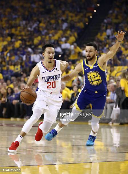 Landry Shamet of the LA Clippers dribbles past Stephen Curry of the Golden State Warriors during Game Five of the first round of the 2019 NBA Western...