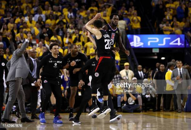Landry Shamet of the LA Clippers is congratulated by Patrick Beverley after he made a basket to put the Clippers ahead of the Golden State Warriors...