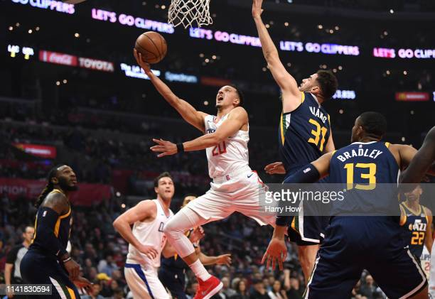 Landry Shamet of the LA Clippers scores past Georges Niang of the Utah Jazz during the first half at Staples Center on April 10 2019 in Los Angeles...